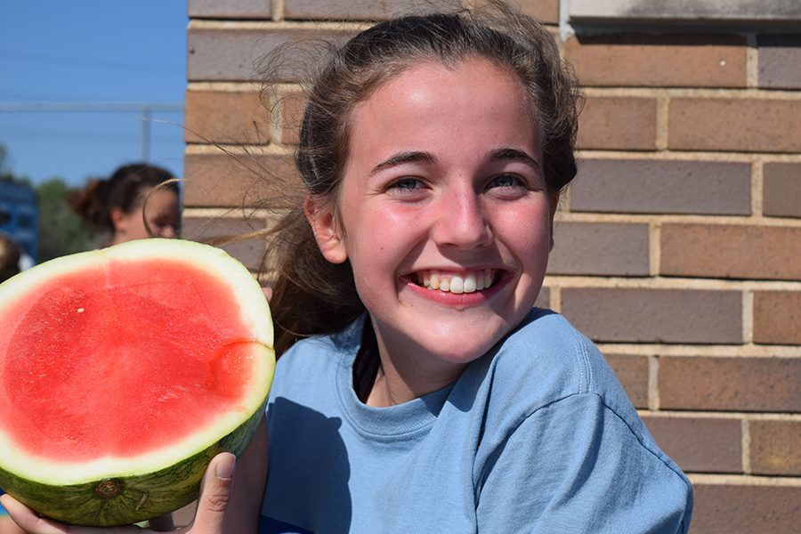 Holding up her watermelon, Managing Editor in Chief Betsy Wait prepares to dig in.