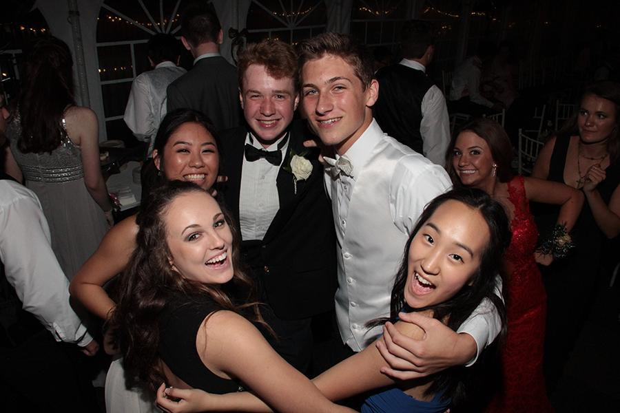 juniors Claire Pellegrino, Annie Doig, Joe Fuller, Gabe Wolf, and Jenny Chai pose for a picture at Prom
