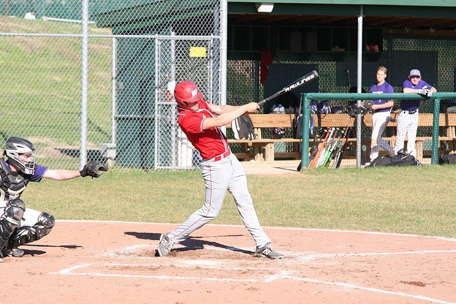 Senior Grant Brueggenjohann hits a double against conference opponent Parkway North on March 28.