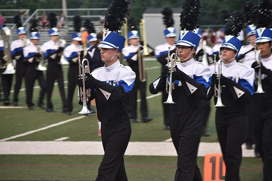 The marching band clears the field after they form a tunnel for the varsity football team at the game on Aug. 26. They performed the first movement of their competition show,