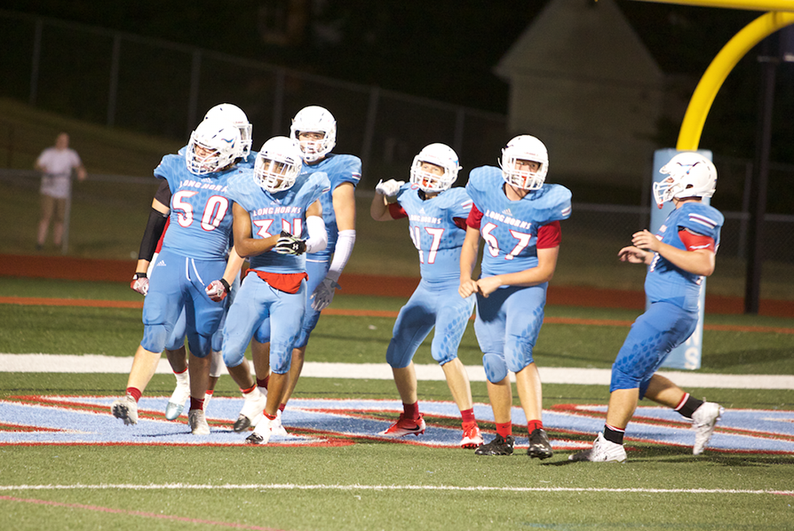 Members of the team rejoice after scoring a touchdown.