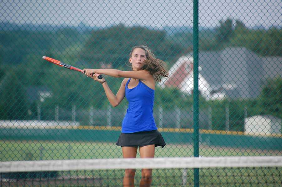 Swinging her racket, freshman Charlotte Zera plays in a singles match against Lafayette at home on Wednesday, Aug. 31.