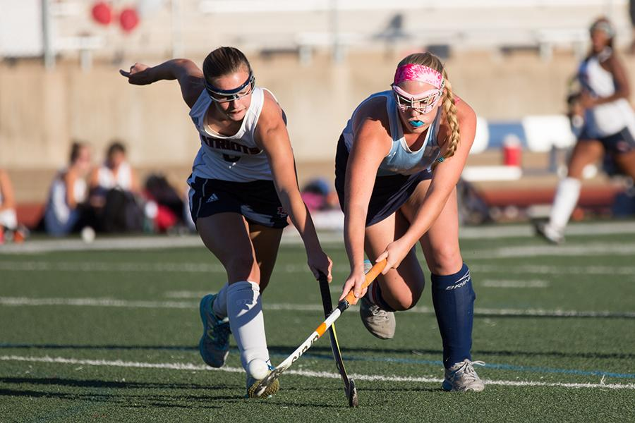 Fighting for the ball, senior Ally Wagner, plays against parkway south on Sept. 27
