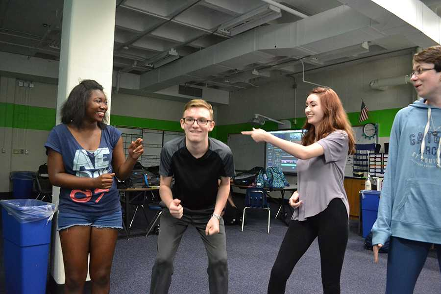 Playing an improv game, juniors Kayla Bell, Kennedy Brown, Hayden Riehl and Ann Truka act out a scene at an after school improv session.