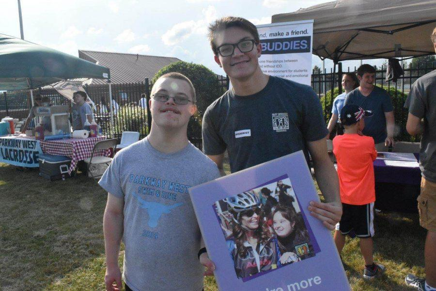 Sophomore and vice president for Best Buddies, Tim McAuliffe and junior, Luke Whitten help promote the club while selling cotton candy at West's annual Red and Blue night.