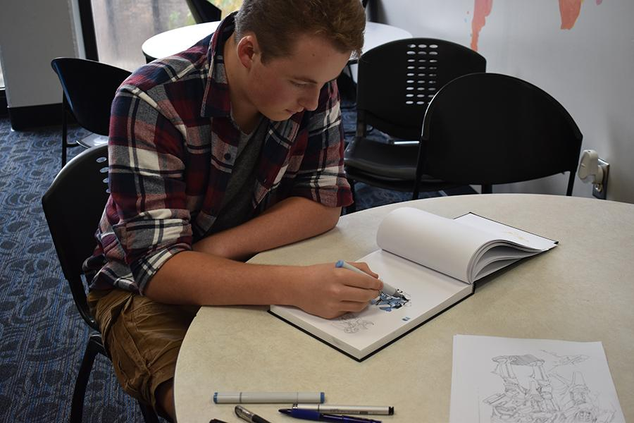 Junior Zach Whistle draws in his sketchbook whenever he gets free time.