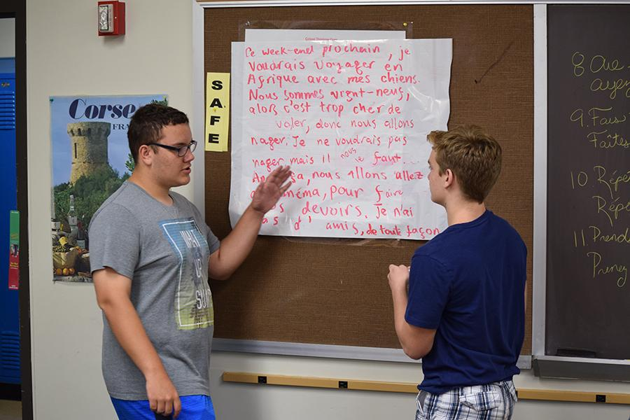 Sophomore Ryan Mound and junior Peter Martin converse in French and write their conversation on the board.