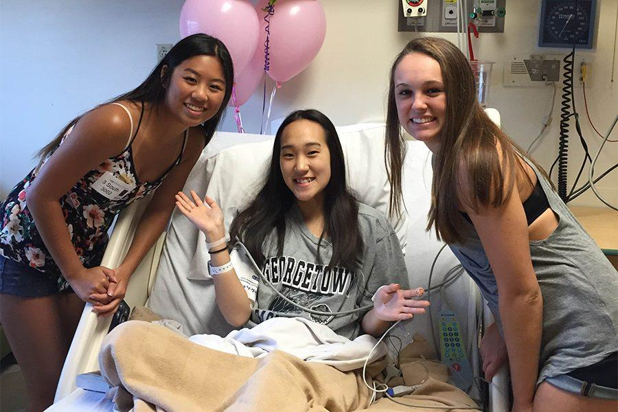 During her treatment for FSG, senior Jenny Chai is visited by friends seniors Annie Doig and Claire Pellegrino at Cardinal Glennon Hospital.