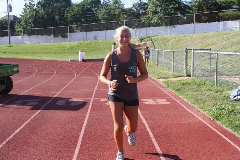 Sophomore Sophie Pellegrino runs at cross country practice. This year is Pellegrino's second year as a member of the club.