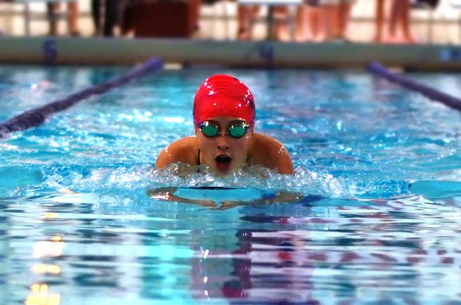 Completing the breast stroke with a PR of 1:19, sophomore Natalie Butler swims at conference at Ladue High School.