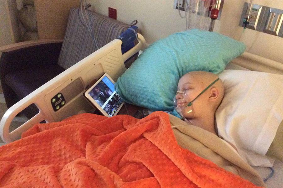 Brynn Haun sleeps after her rib surgery halfway through her cancer treatment.