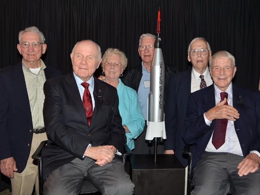 John+Glenn+sitting+among+NASA+engineers+including+Robert+Schepp.