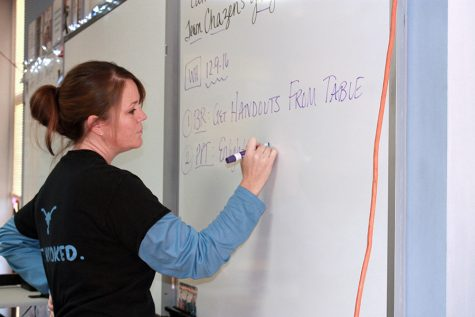 History teacher Amy Thornhill marks directions on the whiteboard during a Modern U.S. history class.