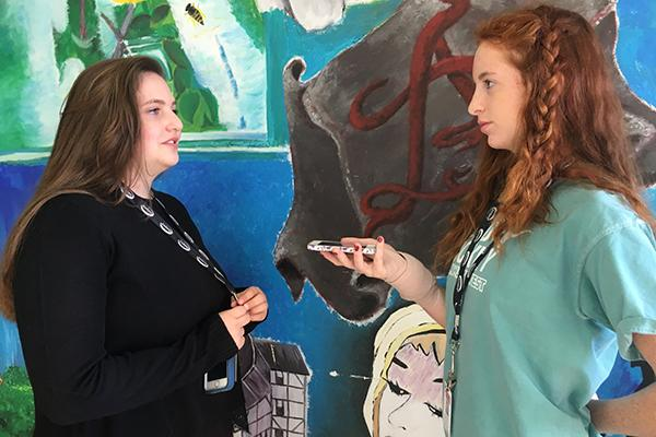 During the week before Thanksgiving, freshmen  Megan Kixmille and Carly Andersen practice with the StoryCorps app in preparation for interviewing their loved ones.