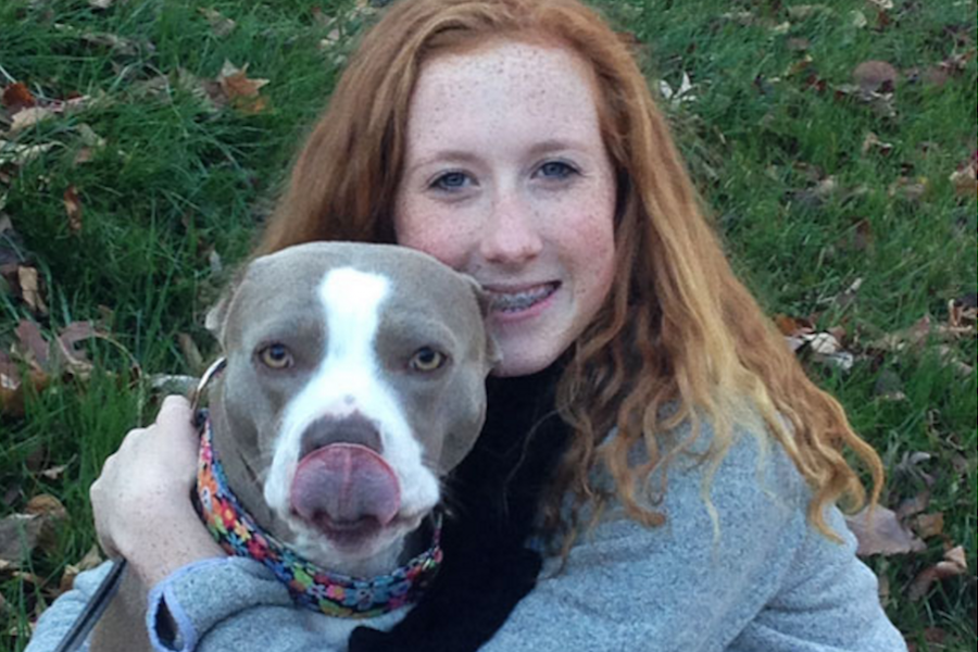 Junior Sydney Veltman poses with her dog, Carlee, in the photo that was submitted to the Petco contest.