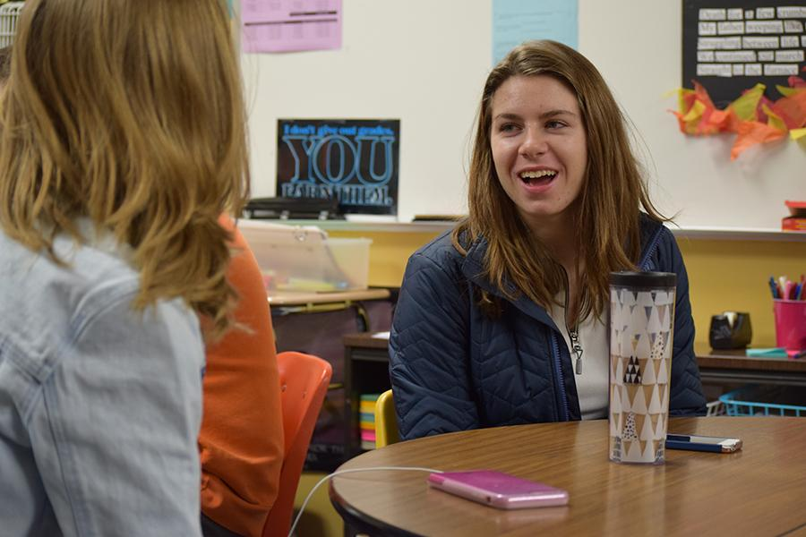 Students talk during a class discussion.
