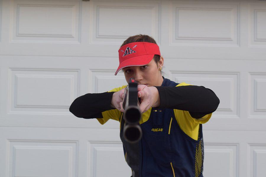 Senior Duncan Mcbride aiming with her double barrel shotgun.