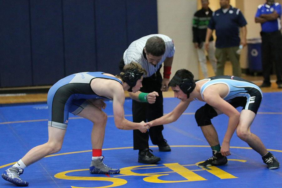 Sophomore Noah Wright shakes hands with his opponent before wrestling at John Burroughs High School on Dec. 2.