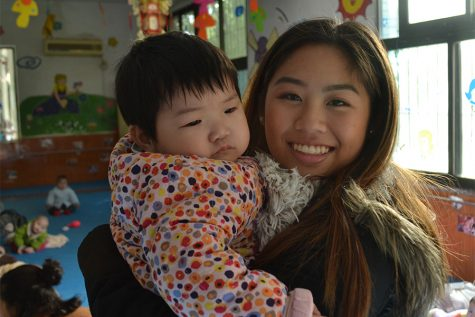 Annie holds a child from the Nanchang orphanage she used to live in.