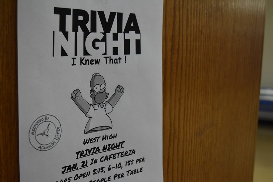 Flyers+featuring+Homer+Simpson+advertise+the+Trivia+night+for+Jan.+21.++