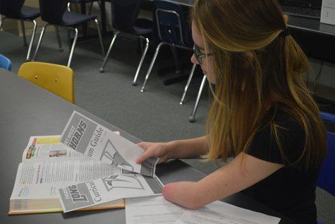 Freshman Gabriel Weber shreds a copy of the school's curriculum guide.