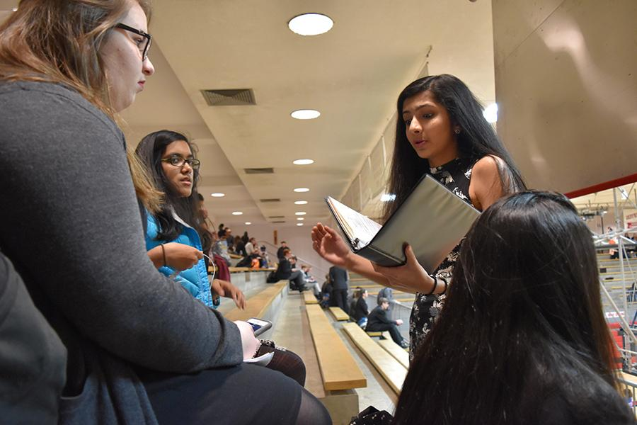 Practicing for her poetry event at the Jefferson City Invitational, held Jan. 28 through 29, junior Khushali Sarnot recites her piece to sophomores Kristina Humphrey and Nina Maitra.