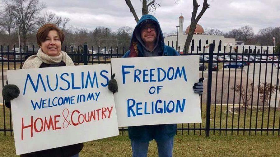 Michele Mordica, an art teacher at Parkway Central Middle, and her husband stand in solidarity with the local Muslim community at the Daar-Ui-Islam Masjid.
