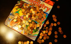 Photo illustration of a textbook covered in coins