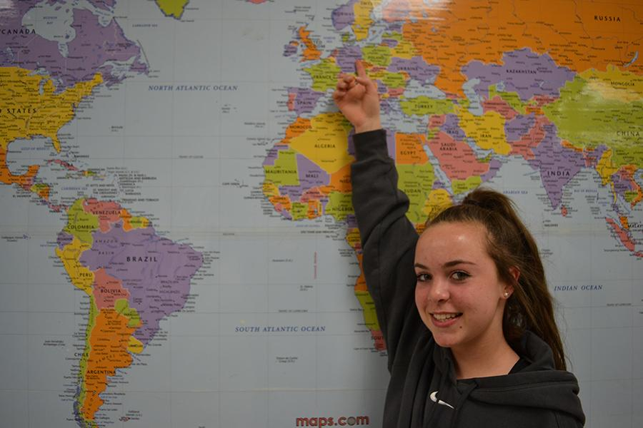 Freshman Rachel Fleming spots Berlin, Germany on the map, one of the destinations on the trip.