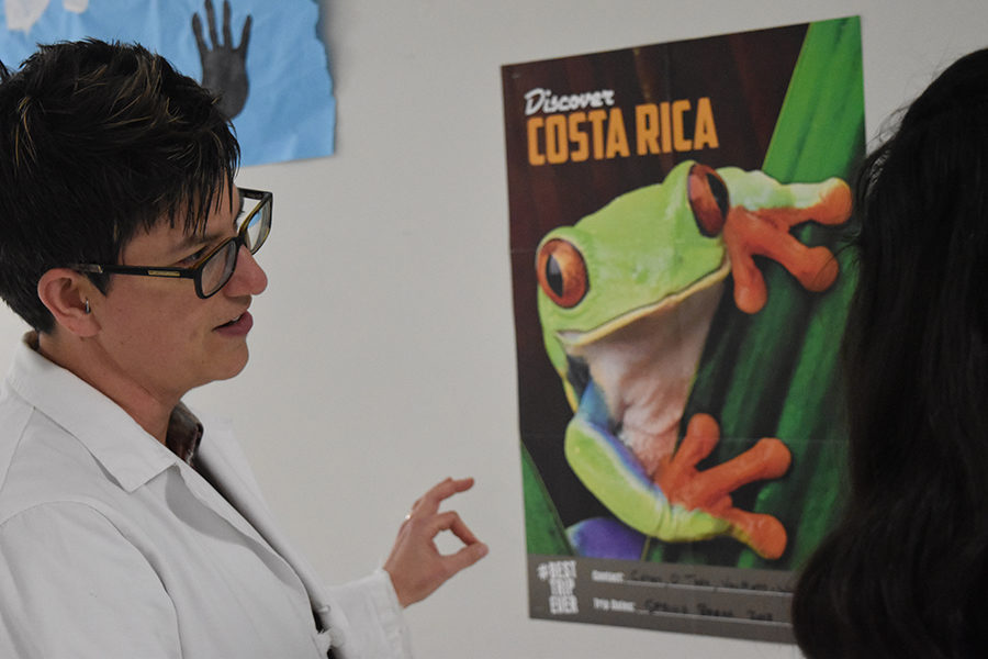 Science teacher Amy Van Matre-Woodward talks to a student about the science department's upcoming trip to Costa Rica.