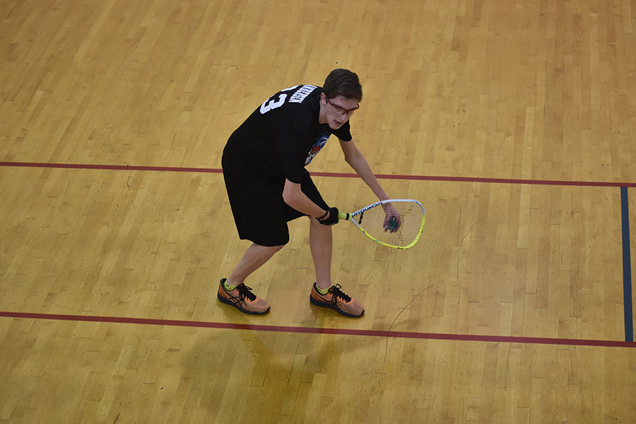 Junior+Kyle+Andersen+crouches+in+preparation+to+serve+the+ball.+Andersen+has+participated+in+the+team+for+three+years.