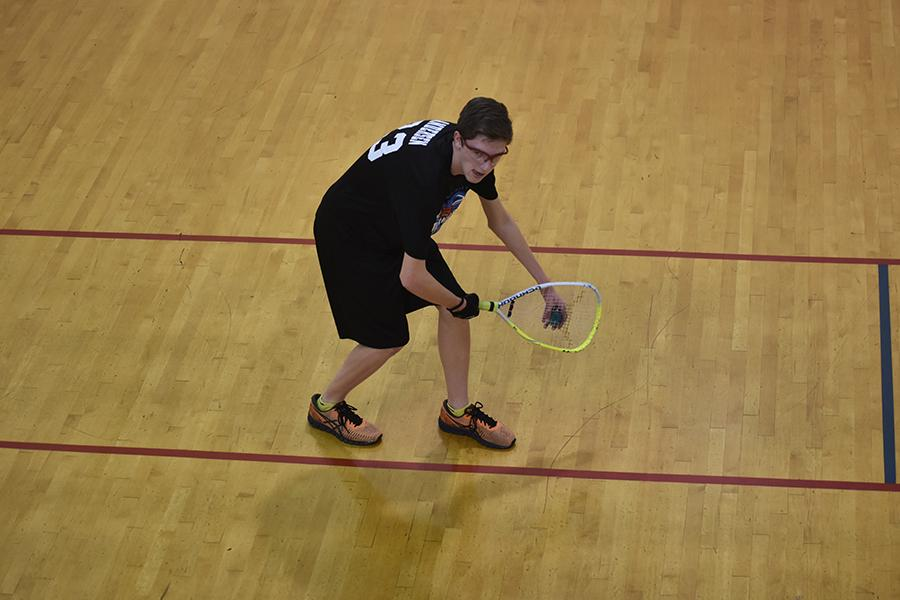 Junior Kyle Andersen crouches in preparation to serve the ball. Andersen has participated in the team for three years.