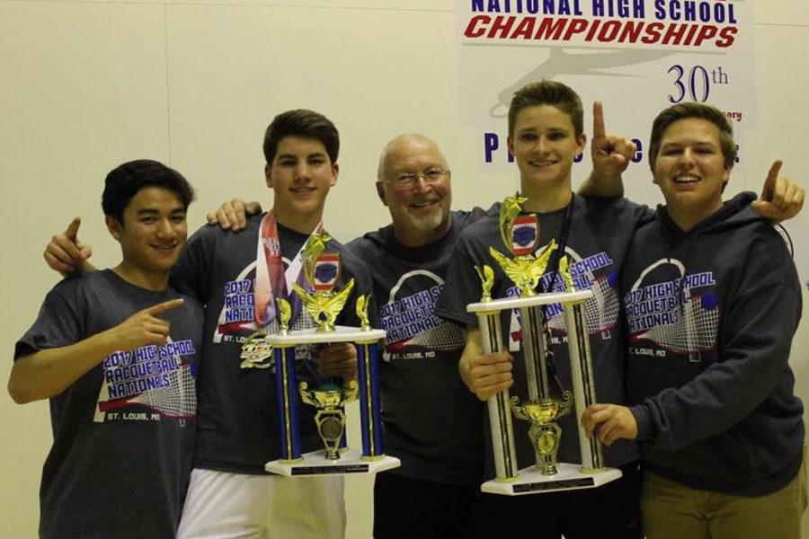 Seniors Tommy Avanzado, Carson Smith, Andrew Deadwyler and Will Meyer hold up their National Championship trophies with their coach Mike Williams.