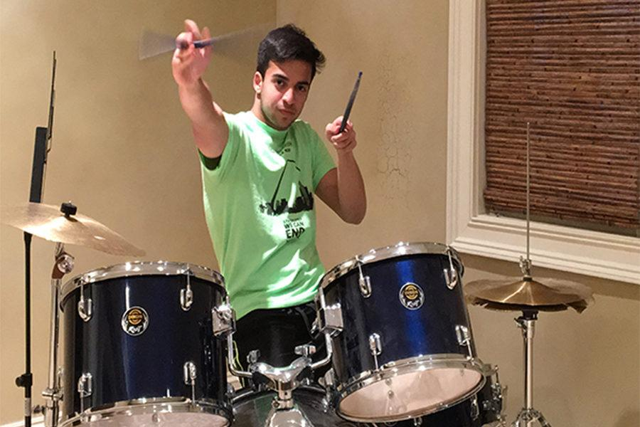 Practicing+the+drums%2C+sophomore+Umer+Mallick+spins+his+stick.