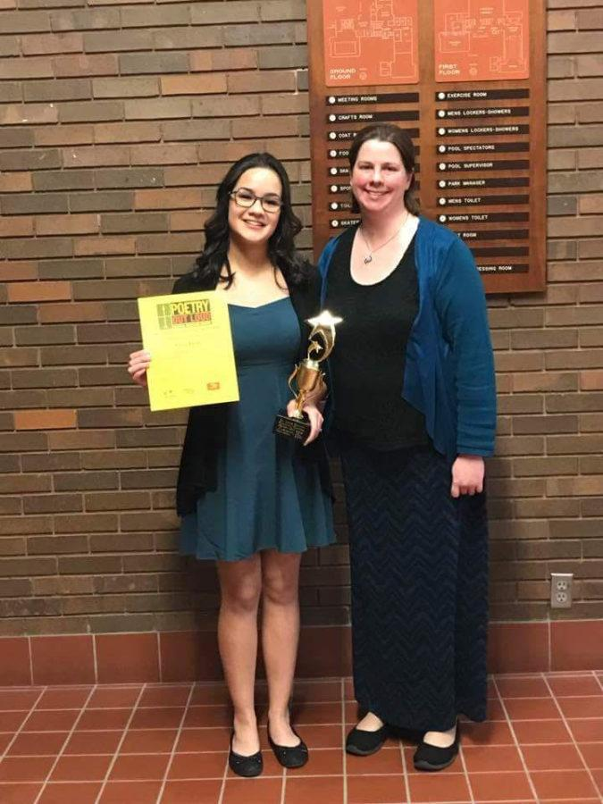 Emily+Bauer+with+Poetry+out+Loud+sponsor+Andria+Benmuvhar+at+the+St.+Louis+Poetry+Out+Loud+competition.