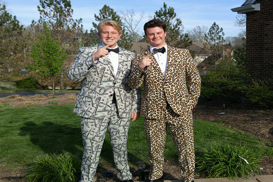 Seniors Andrew Schmidt and Caleb Carswell wear  suits to St. Joseph's Academy Prom.