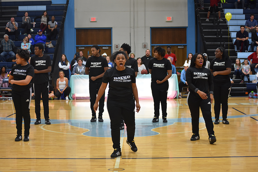 "Senior Je'mya Pore screams at the audience and recites a chant in the gym. ""When you do chants you have to focus yourself and project your voice towards the audience so they can hear,"" Pore said."
