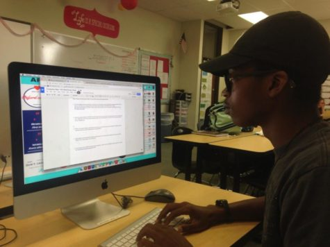 Junior Chris Bass works on his final preparation for his U.S. Government class.