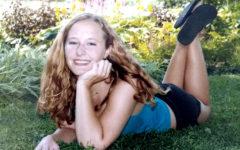 Privett poses in a garden for her senior pictures.