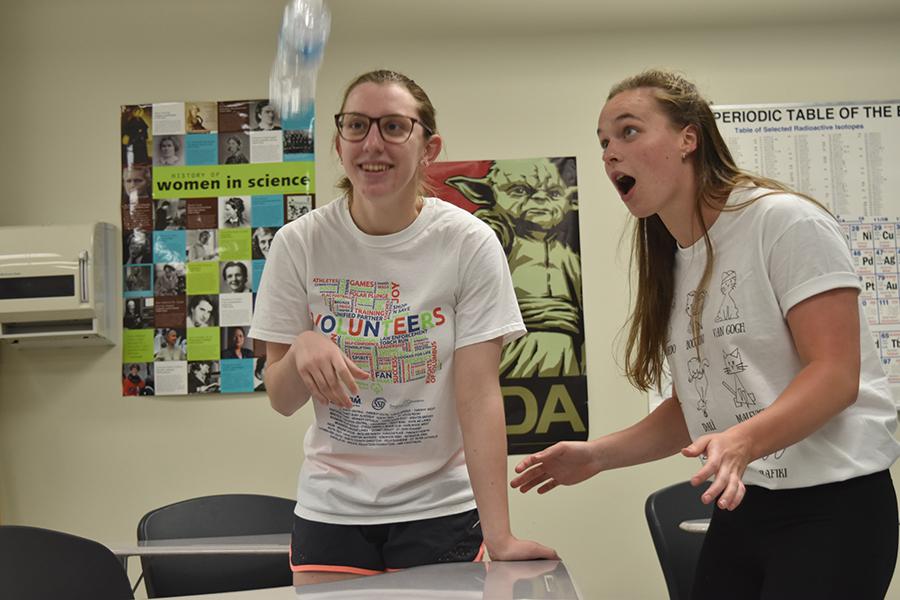 Sophomores Maria Newton and Rachael Newpert flip water bottles, a popular