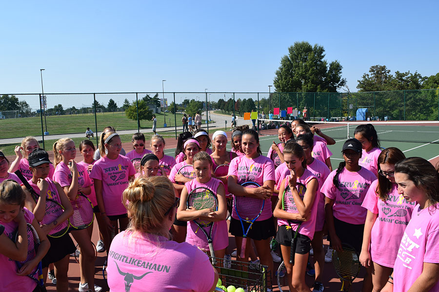 Wearing+t-shirts+in+support+for+Brynn%2C+the+tennis+team+huddles+together+before+their+match+on+Sept.+8.