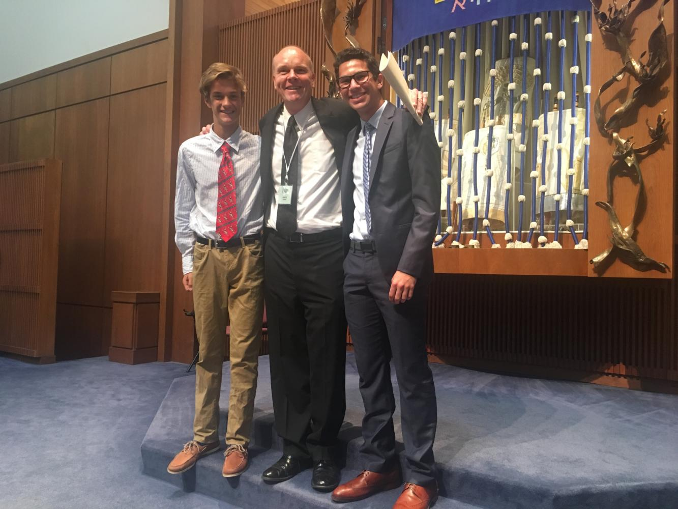 Freshman Joe Rosenberg, Principal Jeremy Mitchell and junior Zach Poscover attend the 9 a.m. Rosh Hashanah service at United Hebrew on Sept. 21.