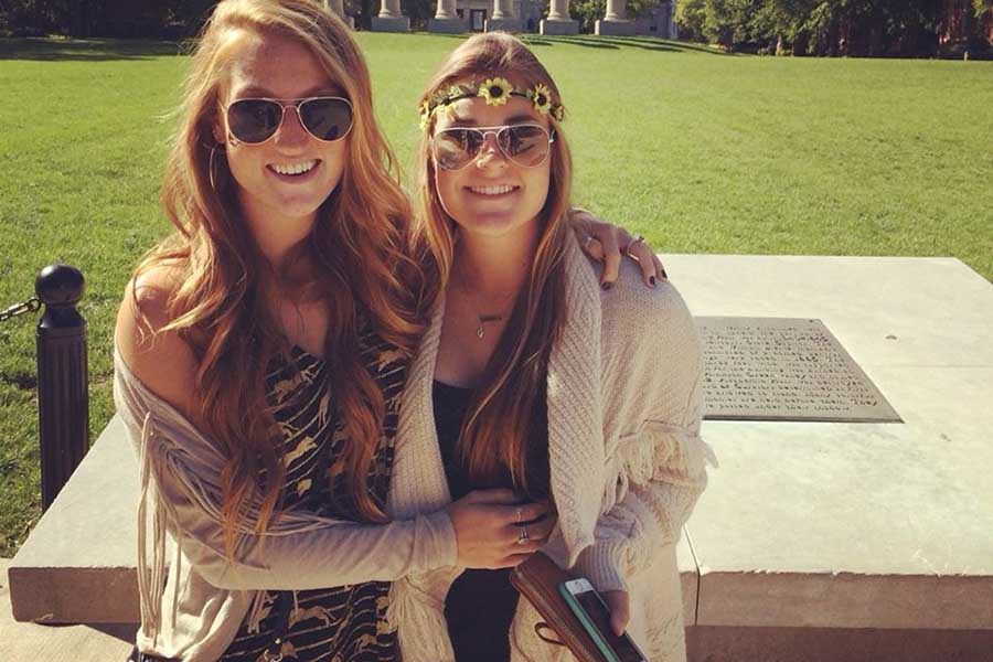 Rose poses with her sister, alumna Maddie Rose in front of the Mizzou columns. Both of the Rose sisters attended Mizzou.