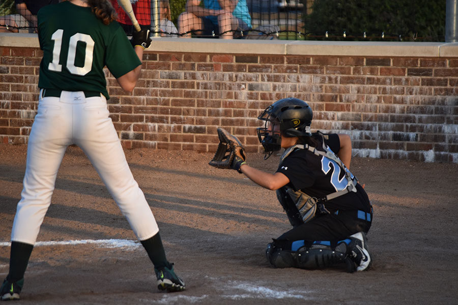 """Glove ready for the pitch, sophomore Theresa Montieleone plays catcher. Catcher was a new position for Montieleone, who used to play shortstop. """"I really wanted to improve my catching this year, specifically being more aggressive and making quick throws to second,"""" Montieleone said."""