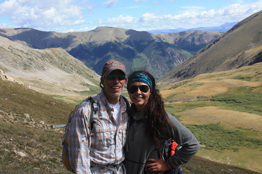 "Standing with her father in front of Mount Missouri in Colorado, Stefanie Elsperman smiles after hiking 12 miles to the top of the mountain. Elsperman sees the outdoors as inspiration for meditation. ""My family loves to go hiking, chilling out and meditating. We're always out at parks with our dogs,"" Elsperman said."