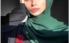 """Senior Bama Nanić poses with her colored ttdeye contacts and green diamante scarves hijab. In 20 hours, the picture gained 3,460 likes. """"Middle school was when I fell in love with makeup, and in high school, I just really felt like stepping my game up,"""" Nanić said."""