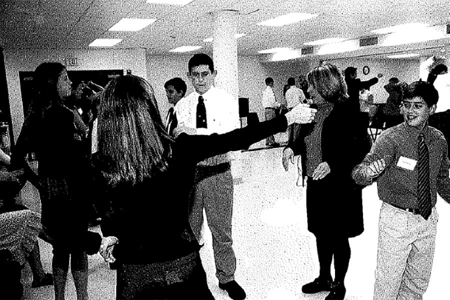 Junior secretary Pam McHardy helps the kids learn how to ballroom dance.