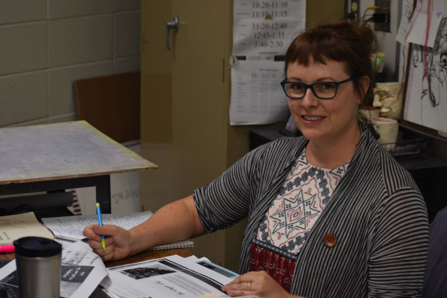 Art teacher Ashley Drissell goes through her folder of plans for We Dine. She based West's chapter of We Dine after a club in Florida.