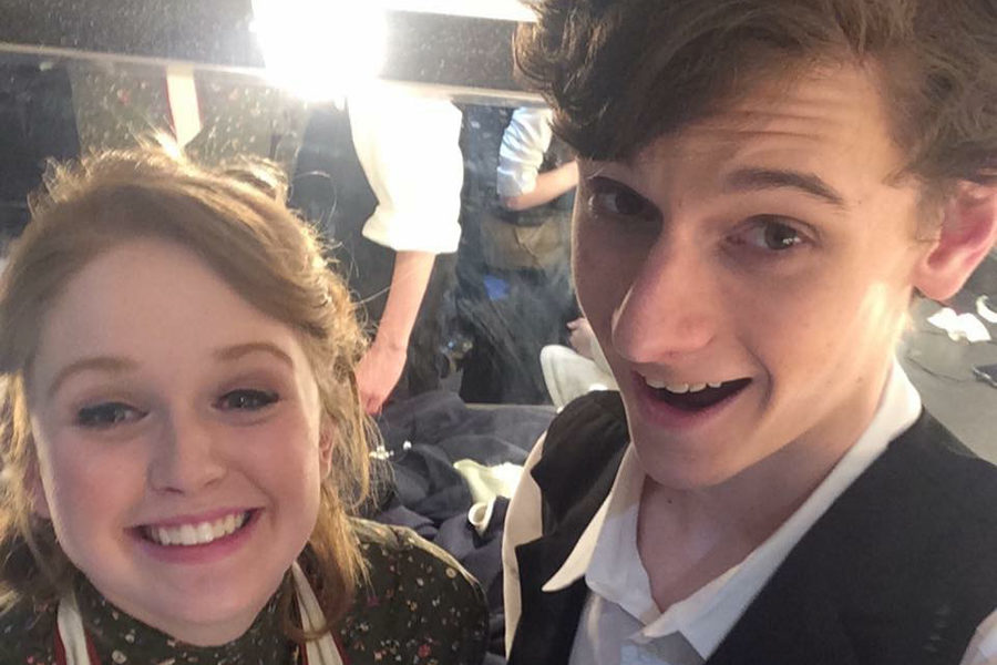 """Smiling for a selfie with senior Drew Silverberg, junior Kathryn Harter prepares to go on stage for """"Our Town"""" to play Myrtle Webb at Parkway West in 2015."""