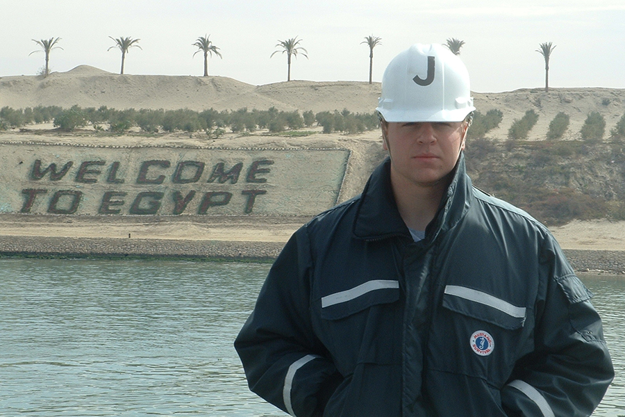 Jaskowiak poses for a picture in the Suez Canal while on a tour of duty in 2006. He was stationed on the U.S.N.S. Bighorn and traveled around Africa on this deployment.